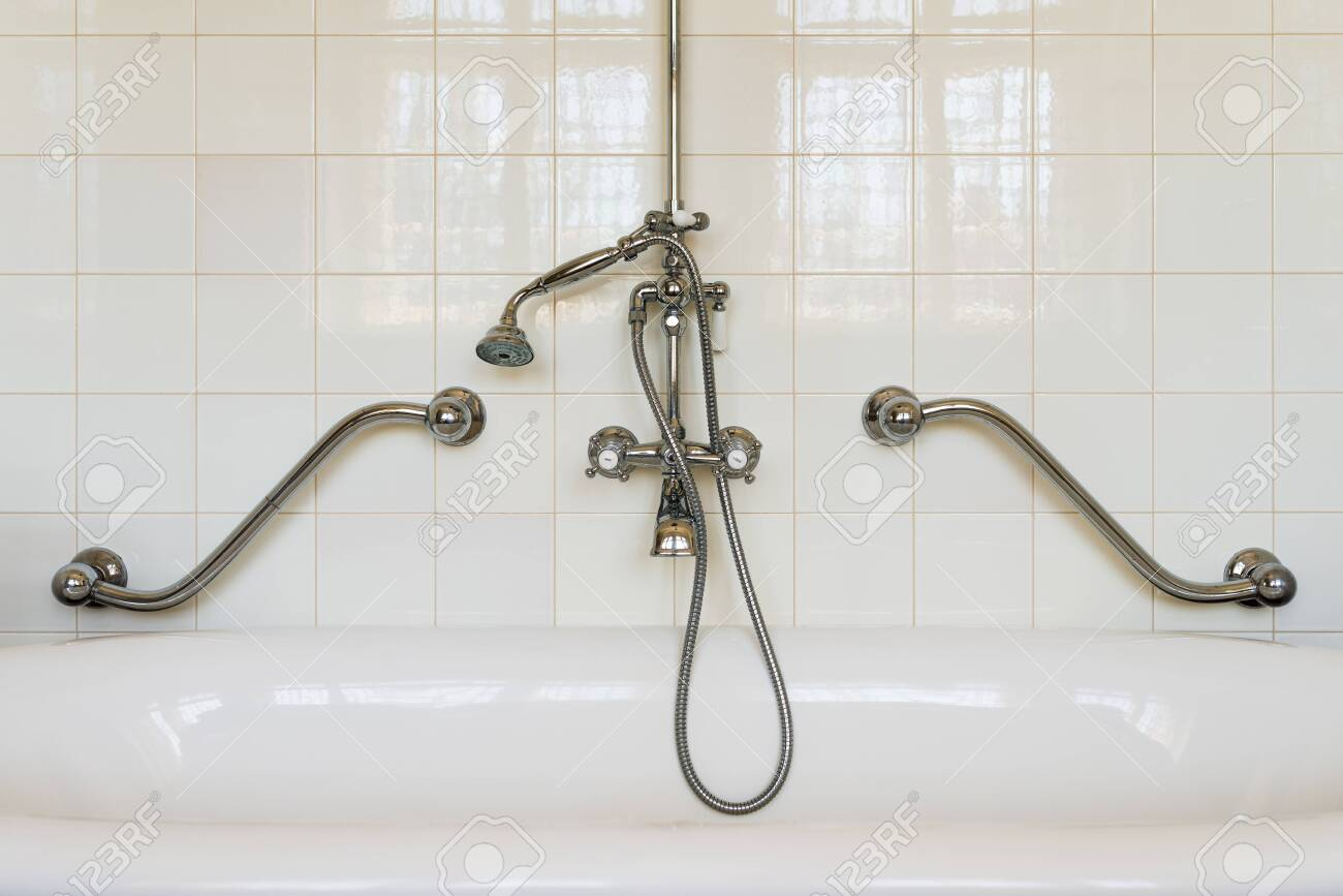 https www 123rf com photo 139302890 old stylish retro bathtub with a traditional shower faucet in a white tiled bathroom with metal hand html