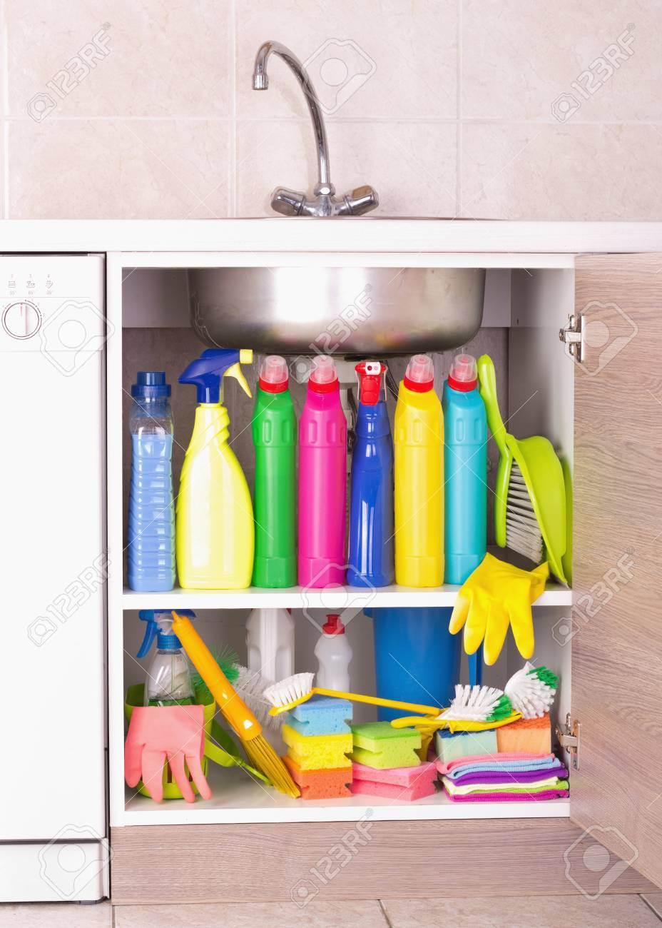 cleaning products placed in kitchen cabinet under sink housekeeping