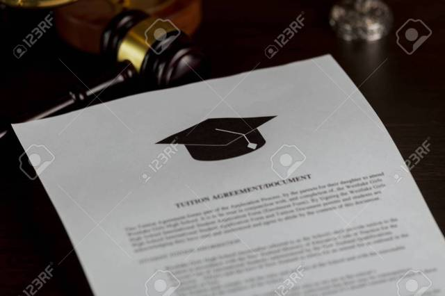Man Reading College Or University Application Or Document From