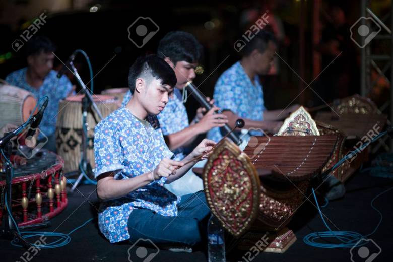 bangkok - january,20 : thai students are playing thai traditional