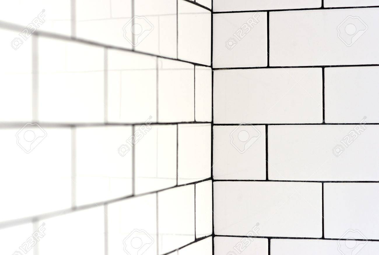 white vintage metro tiles and black grout in a bathroom stock photo picture and royalty free image image 56283627