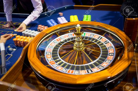 Roulette Table In Casino. Ball In The Rotating Gambling Machine... Stock  Photo, Picture And Royalty Free Image. Image 84968218.