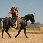 Two Beautiful Young Women Horseback Riding On A Black Stallion Stock Photo Picture And Royalty Free Image Image 6422251