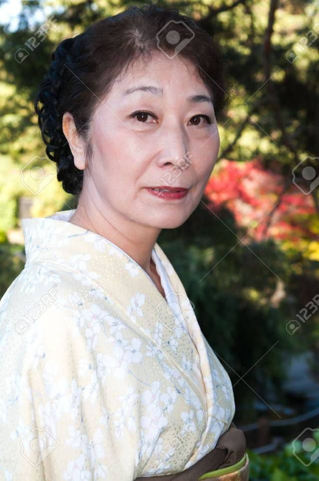 Mature Woman In A Traditional Japanese Outfit Stock Photo 13270124