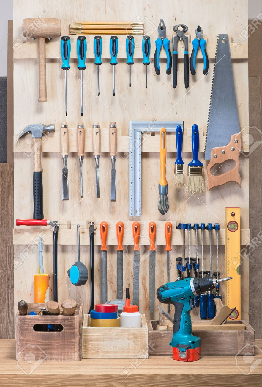 garage tool rack with various tools and repair supplies on board