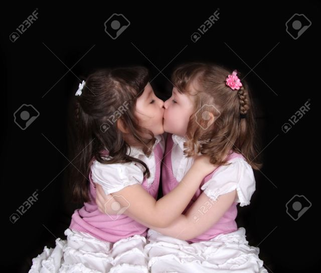 Stock Photo Sweet Twin Girls Kissing Isolated On Black