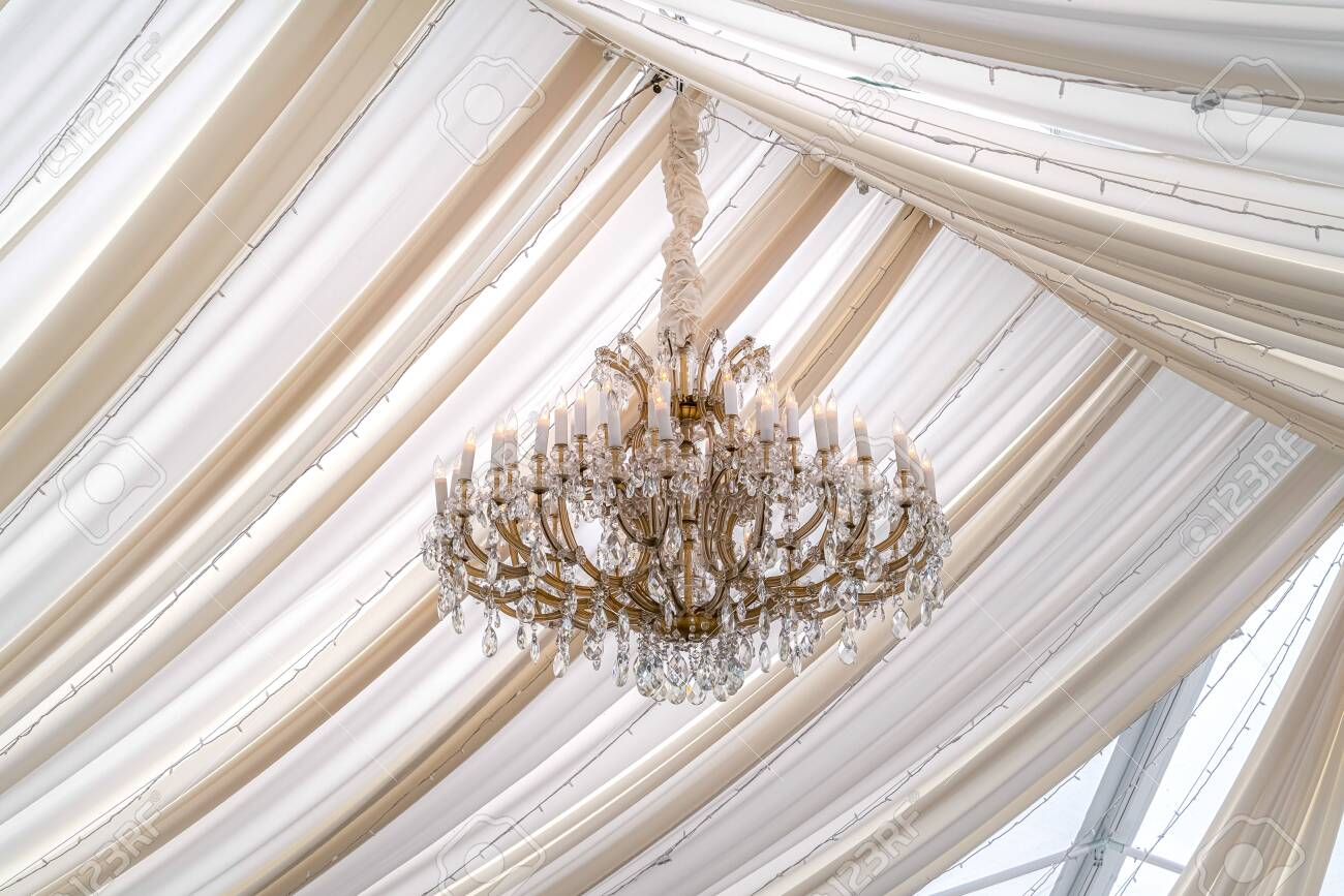Beautiful Chandelier With Crystals And Faux Candles At A Wedding Stock Photo Picture And Royalty Free Image Image 132668984
