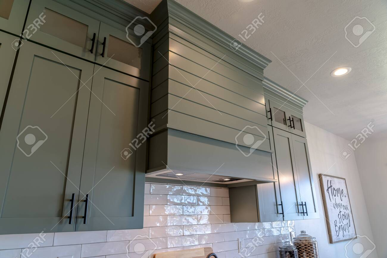 https www 123rf com photo 139153286 kitchen interior with hanging cabinets against tile backsplash and ceiling wall decoration and jars html