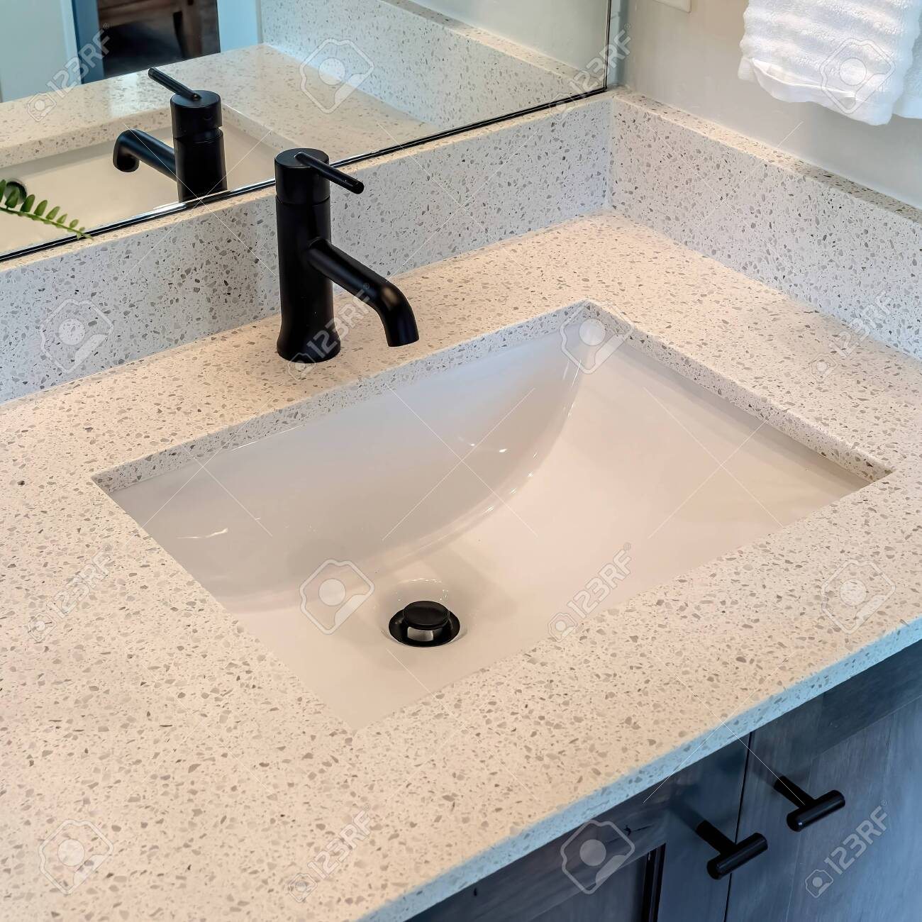 https www 123rf com photo 149183842 square bathroom white countertop with single basin undermount sink and black faucet cabinets hanging html