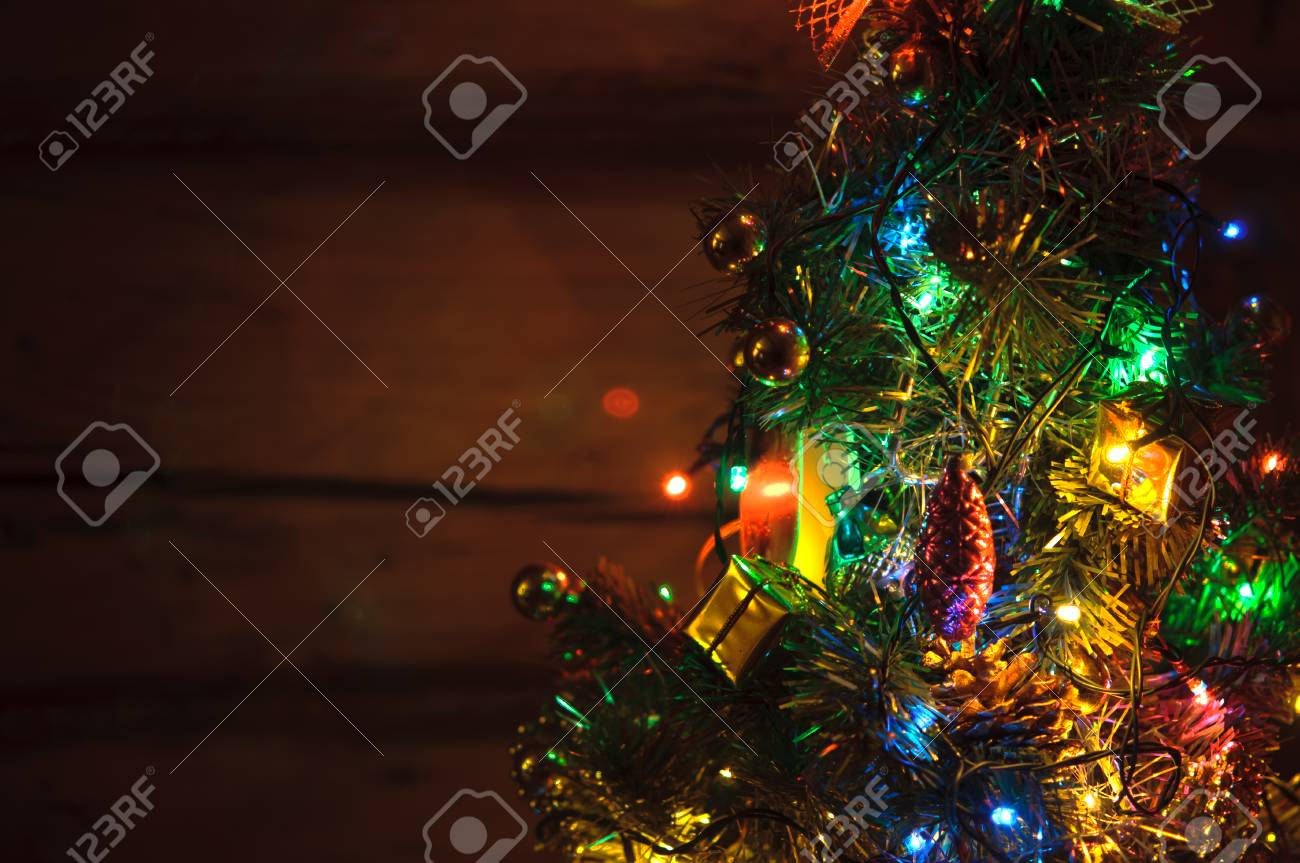 Small Christmas Tree With Multi Colored Lights At Dark Countryside Stock Photo Picture And Royalty Free Image Image 115921228