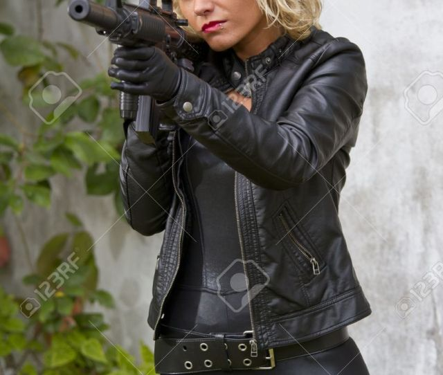 Sexy Female Agent With Silencer Machine Gun Outdoor Stock Photo