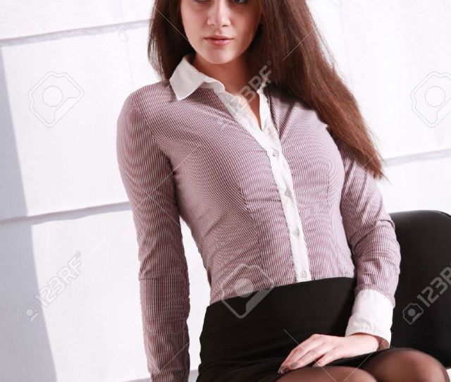 Sexy Secretary In Blouse And Mini Skirt Sitting In A Office Stock Photo 48294921