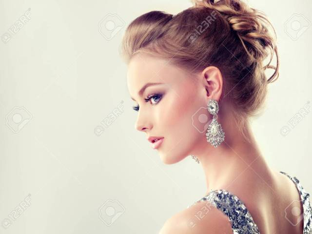 portrait of young gorgeous girl in a profile dressed in evening