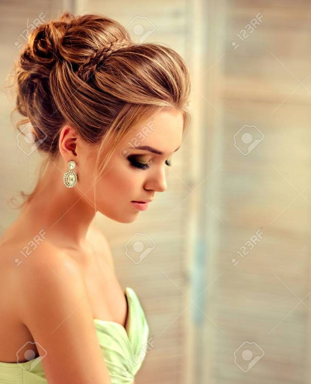 beautiful woman dressed in evening gown. example of wedding hairstyle..