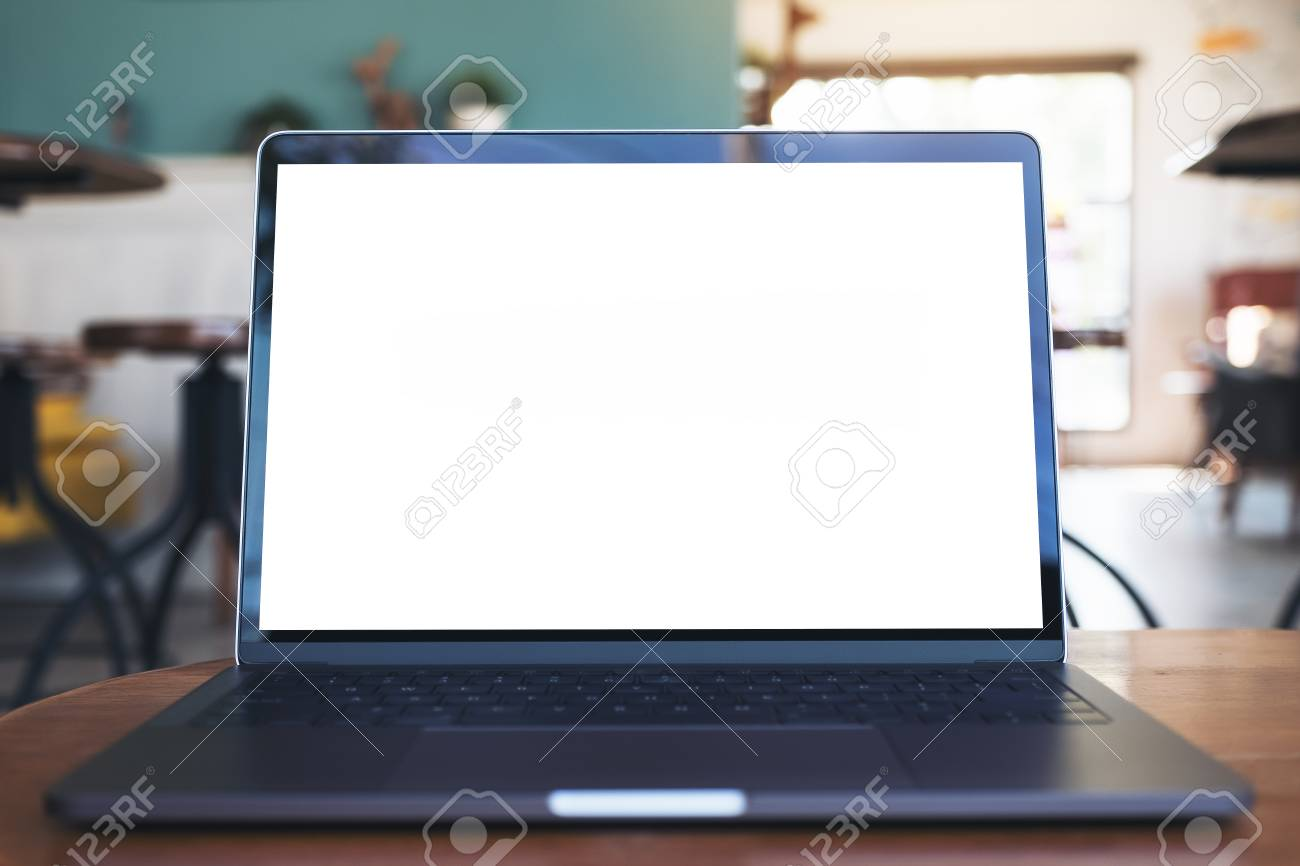Mockup Image Of Laptop With Blank White Desktop Screen On Wooden