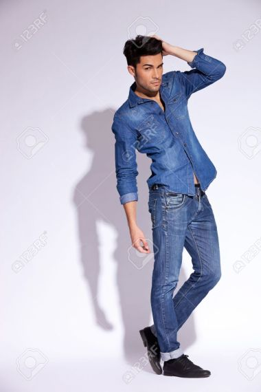 Full Body Picture Of A Fashion Young Man With His Hand On Head Stock     full body picture of a fashion young man with his hand on head Stock Photo