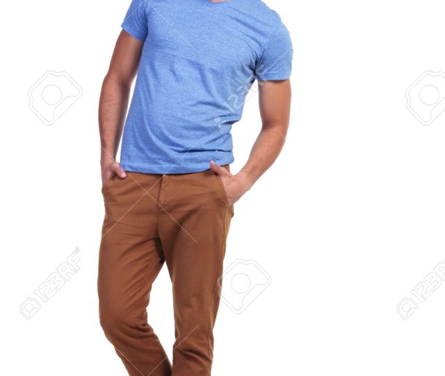Full Body Picture Of A Young Casual Man Standing With Hands In Pockets And Smiles Stock