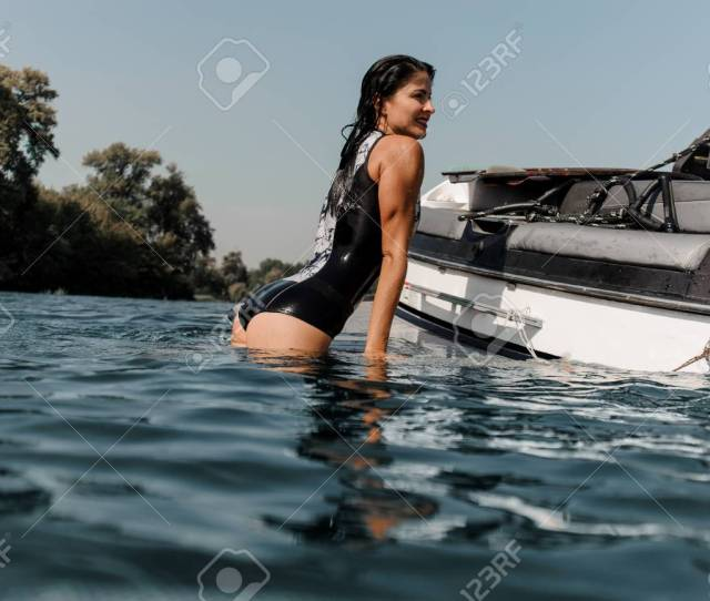 Brunette Girl With Nice Ass In The Black And White Swimsuit Climbing On The Motorboat On