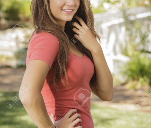 Attractive Mixed Race Girl Portrait Outdoors Stock Photo