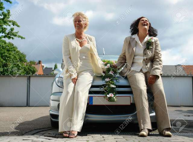 Mature Lesbian Couple Posing After Official Same Marriage Ceremony This Type Of Marriage Is