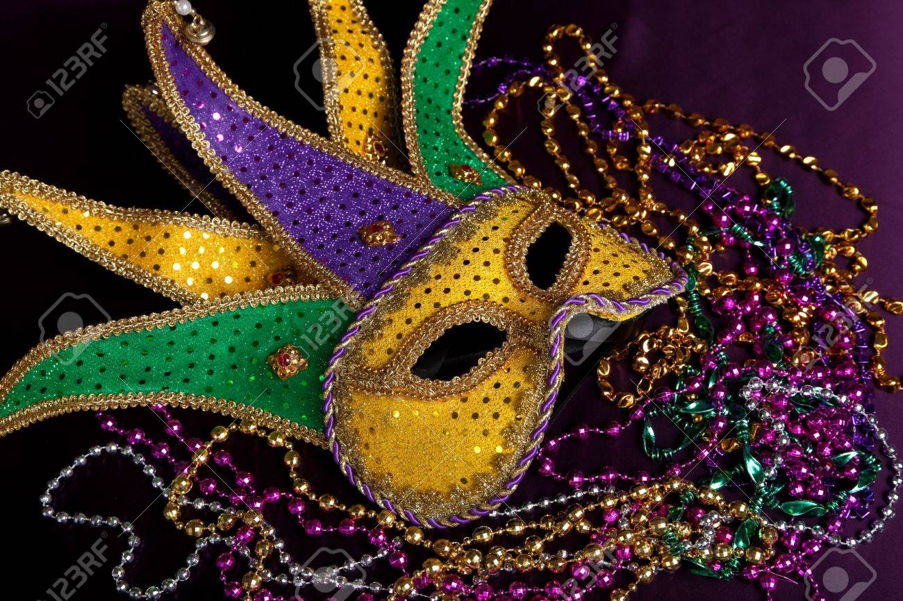 Glittery Gold Green And Purple Mardi Gra Mask With Beads On Stock Photo Picture And Royalty Free Image Image 5723482