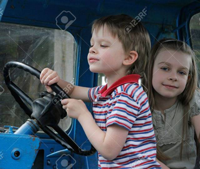 Brother And Sister First Time In Tractor Cab Stock Photo 7736537