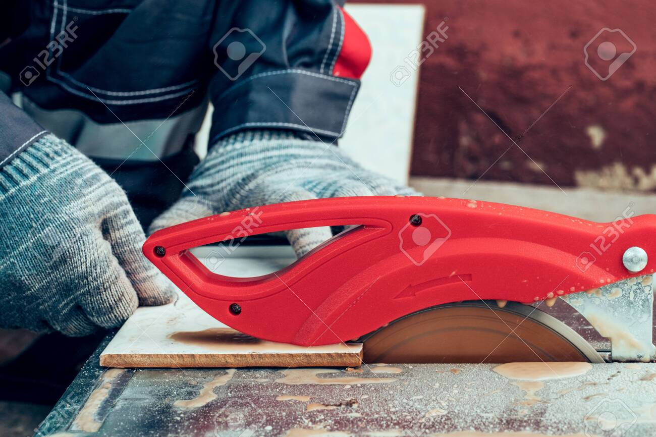 cutting floor tiles using tile cutter machine cutting ceramic stock photo picture and royalty free image image 127108429