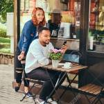 A Couple Dating Drinking Coffee Sitting Near The Coffee Shop Stock Photo Picture And Royalty Free Image Image 98320225