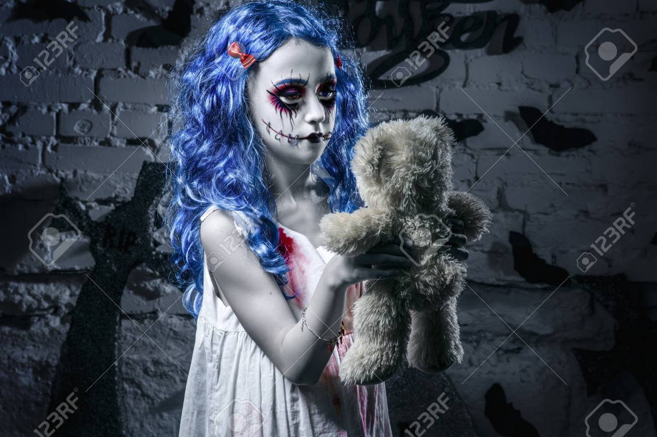 This quick history lesson will help you understand how this festive holiday began. Little Blue Hair Girl In Bloody Dress With Scary Halloween Makeup With Teddy Bear Stock Photo Picture And Royalty Free Image Image 87157175