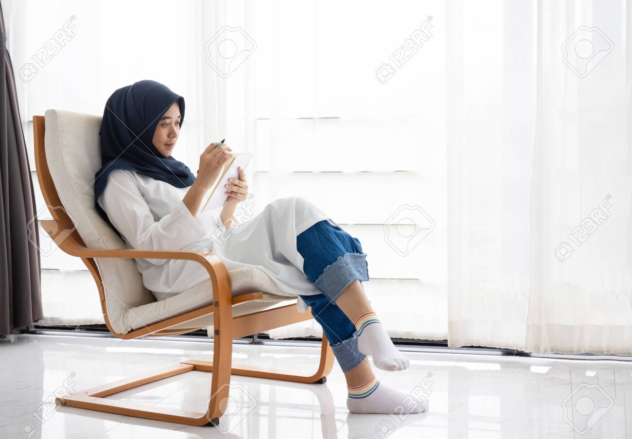 She's living her dream and, in the process,. Young Muslim Women Students Is A Creative Freelance Journalist Sit Writing To Be Entrepreneur Job Concept For Hijab Girl Islam Religion Asian Ethnic Joyful Internet Banking On Tablet Mobile Smartphone Stock Photo