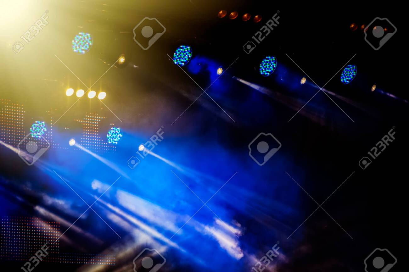 https www 123rf com photo 124228267 stage lighting during a concert of a rock band night view html