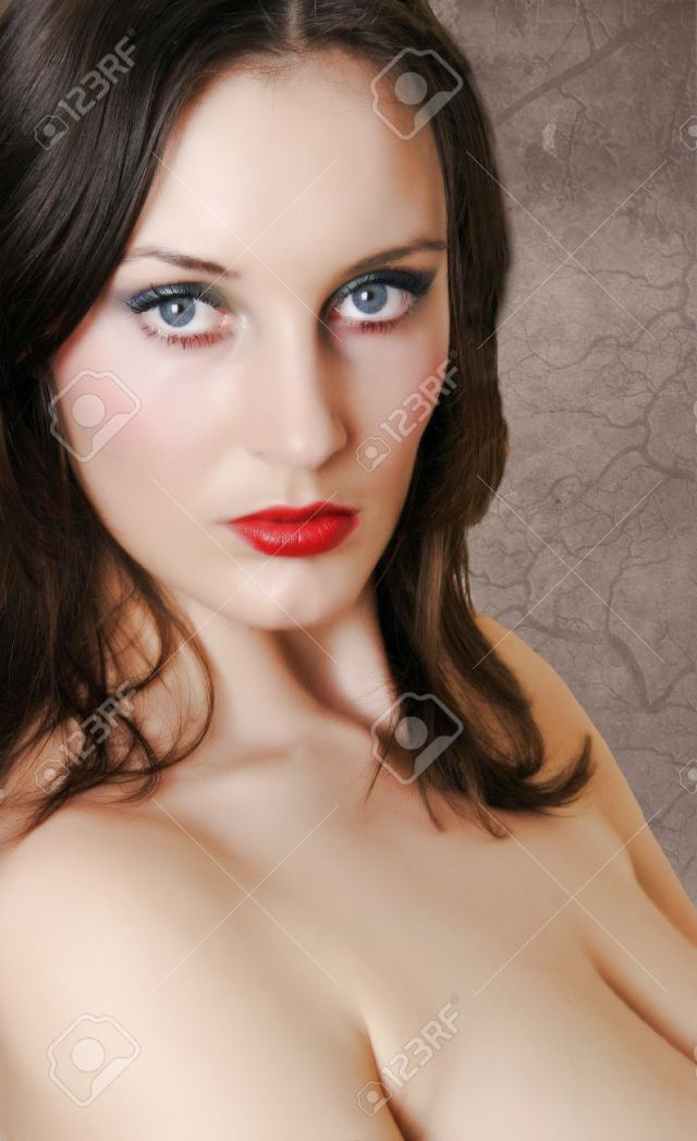 Busty Brunette Teen 19s With Strong Make Up Stock Photo 4160745