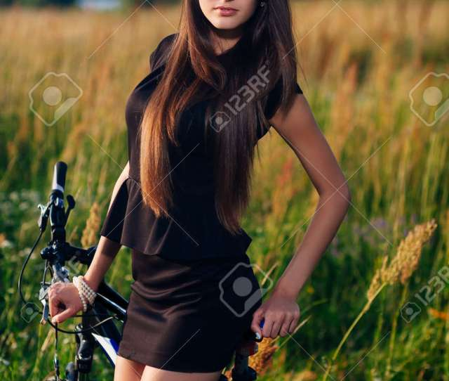 Gorgeous Brunette In Glasses Outdoors With Bike Stock Photo 23779560