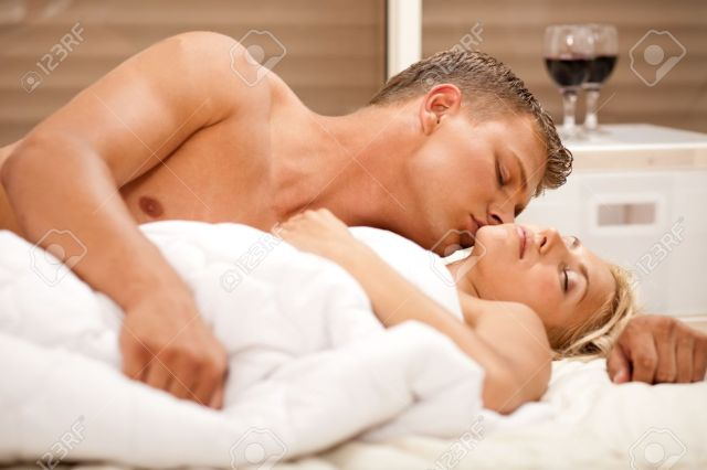 Image result for a man who kiss his wife in bed