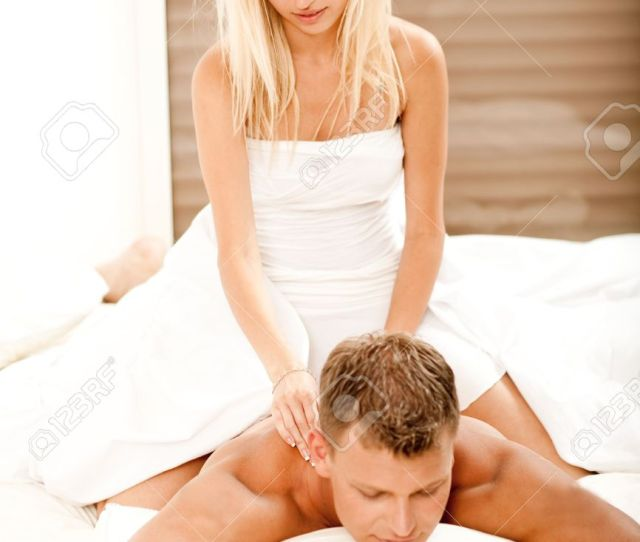 Stock Photo Young Woman Giving Romantic Massage