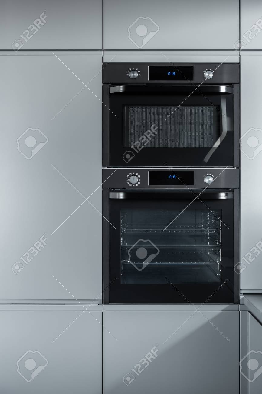 modern black built in oven and microwave between grey cabinets stock photo picture and royalty free image image 91474758