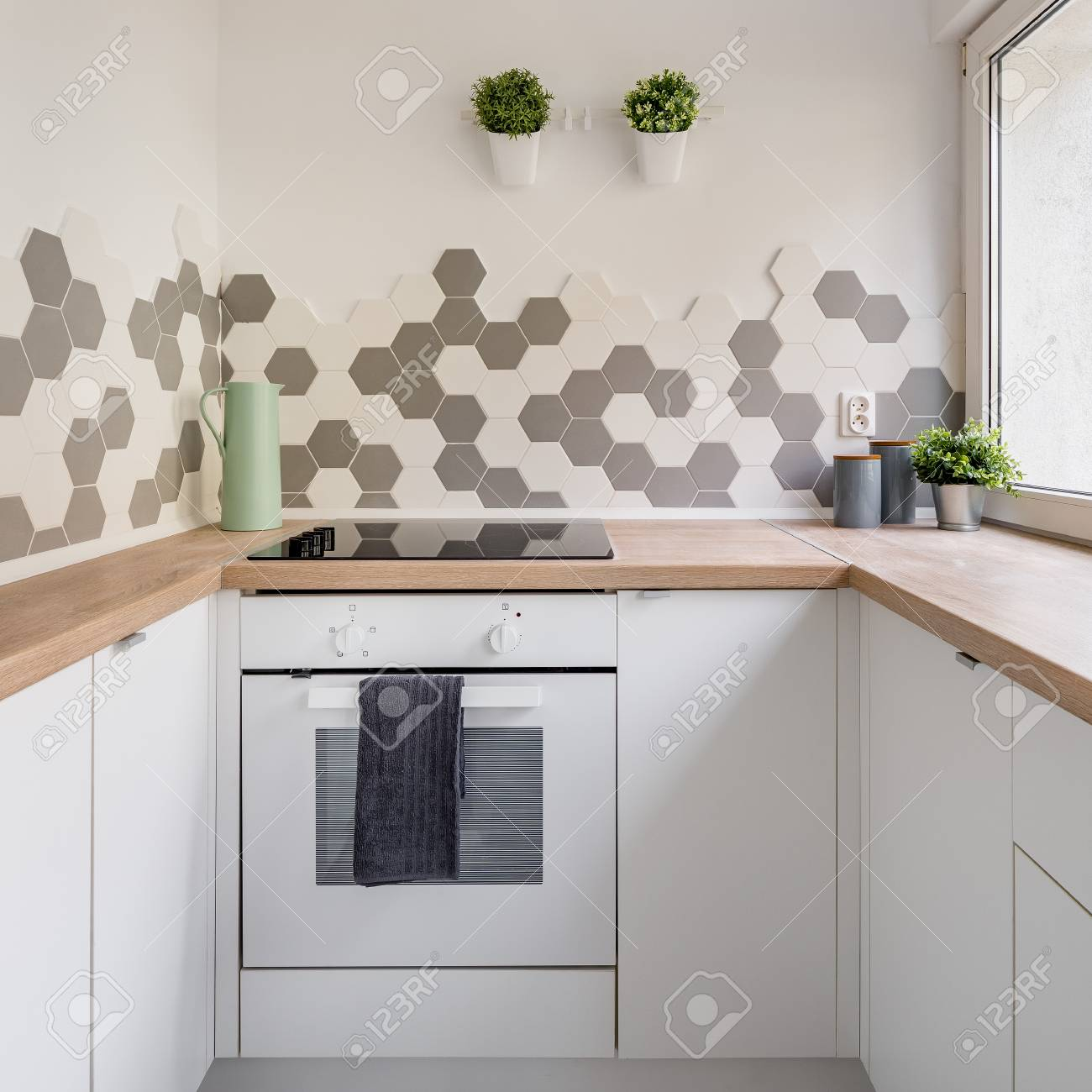 Kitchen In Nordic Style With White Cabinets Wooden Countertop Stock Photo Picture And Royalty Free Image Image 105300206