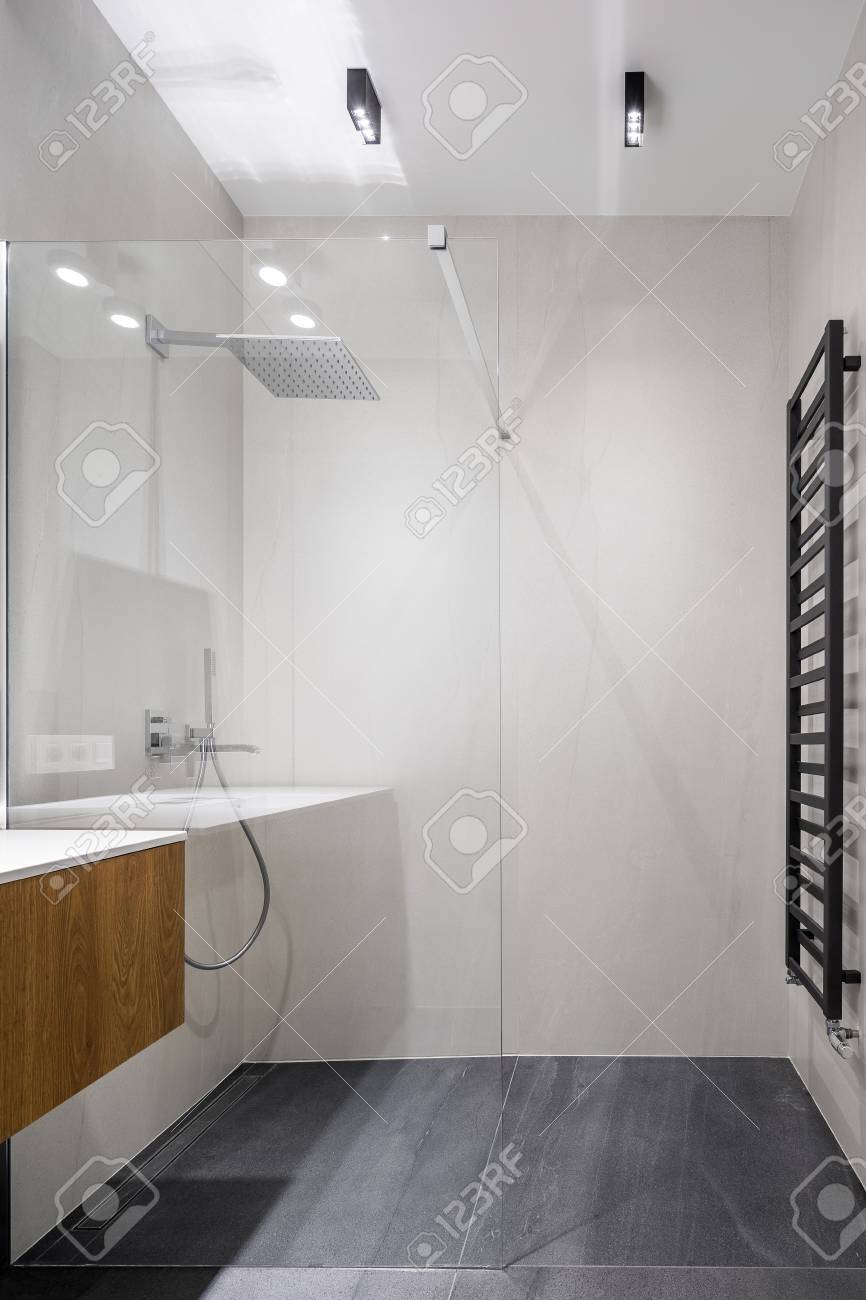 white bathroom with walk in shower and gray floor tiles stock photo picture and royalty free image image 119653629