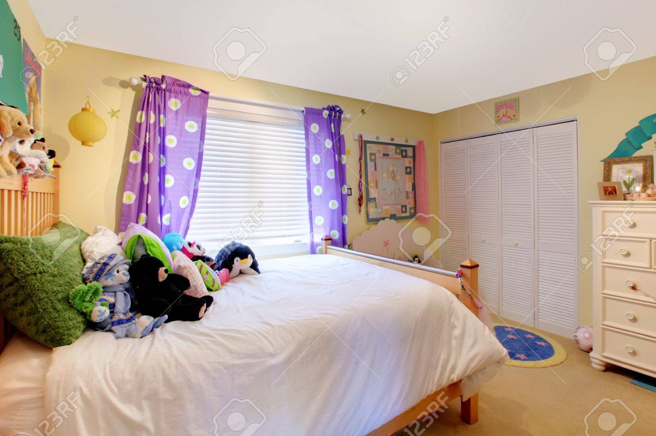 Yelow Baby Room With Purple Curtains And Yellow Walls Stock Photo Picture And Royalty Free Image Image 12621208