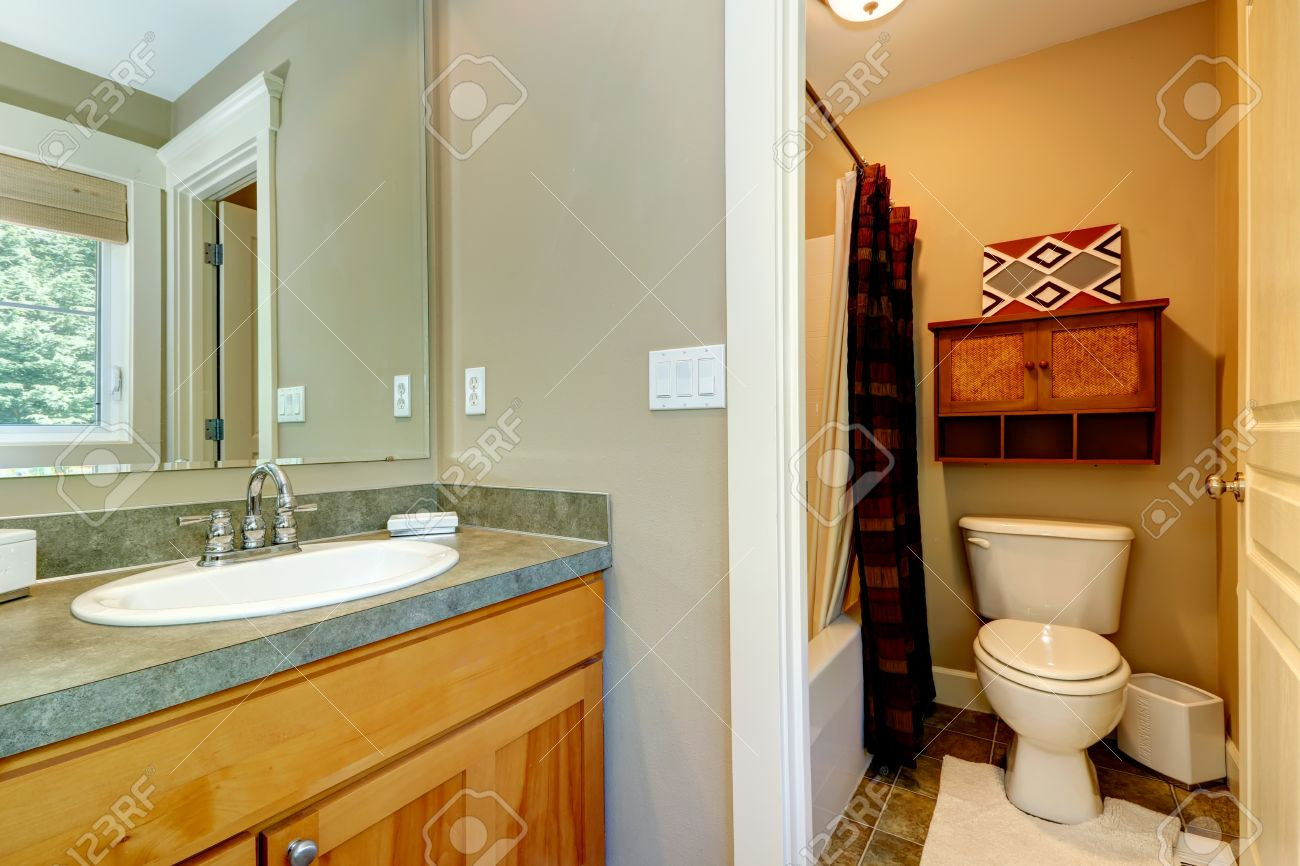view of washbasin cabinet and small bathroom in master bedroom stock photo picture and royalty free image image 26867379