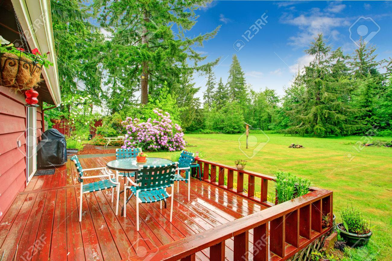 https www 123rf com photo 27498560 countryside house with walkout red deck patio table with pleated chairs html