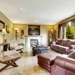 Luxury Living Room Interior With Fireplace Furnished With Burgundy