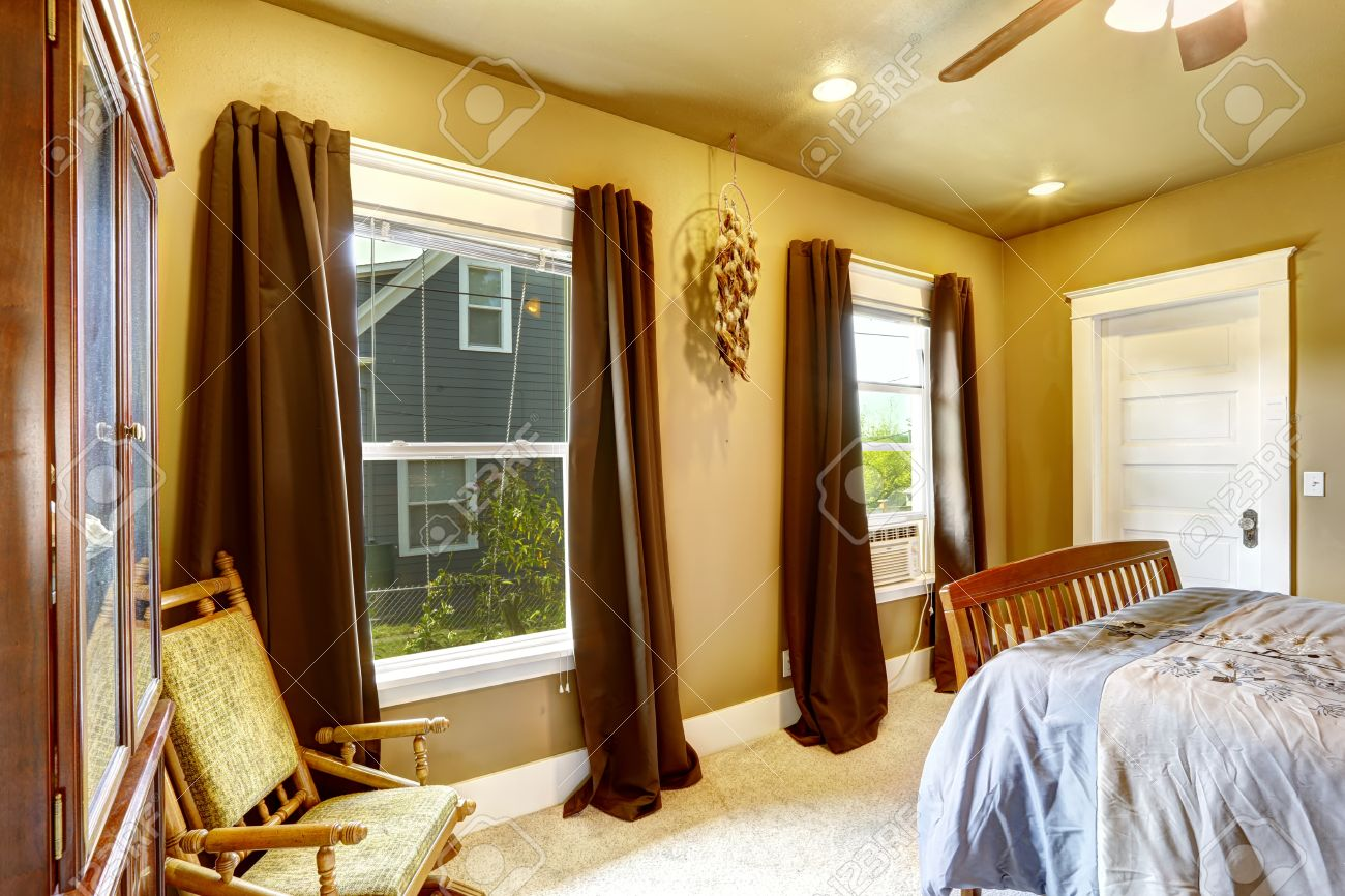 Warm Tones Bedroom With Light Yellow Walls And Brown Curtains Stock Photo Picture And Royalty Free Image Image 31606291