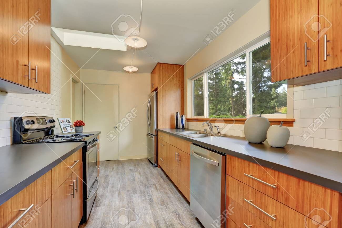 Narrow Kitchen Room With Long Grey Countertops Modern Cabinets Stock Photo Picture And Royalty Free Image Image 67381660