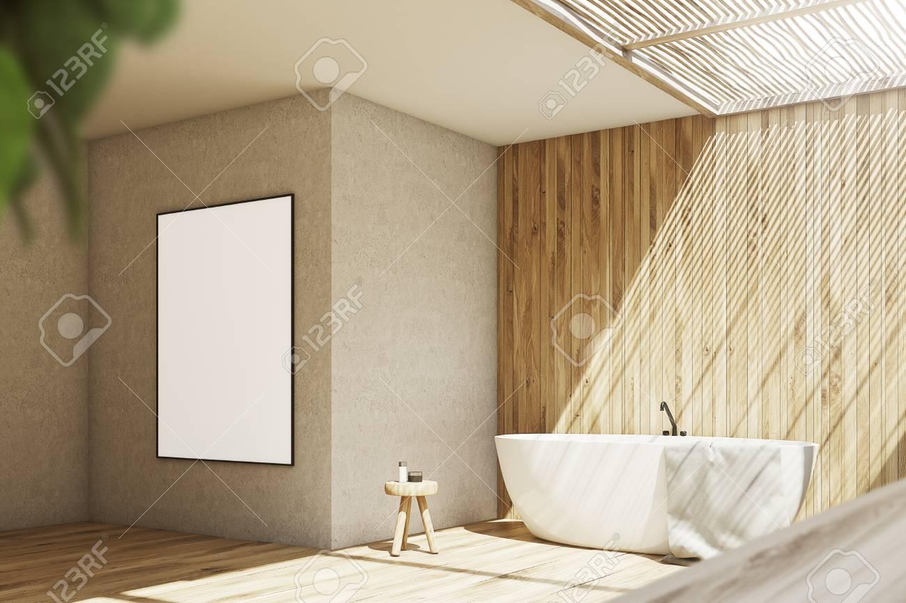 interieur de salle de bain en bois et beige avec une baignoire blanche une petite chaise avec des cremes une serviette et une grande affiche