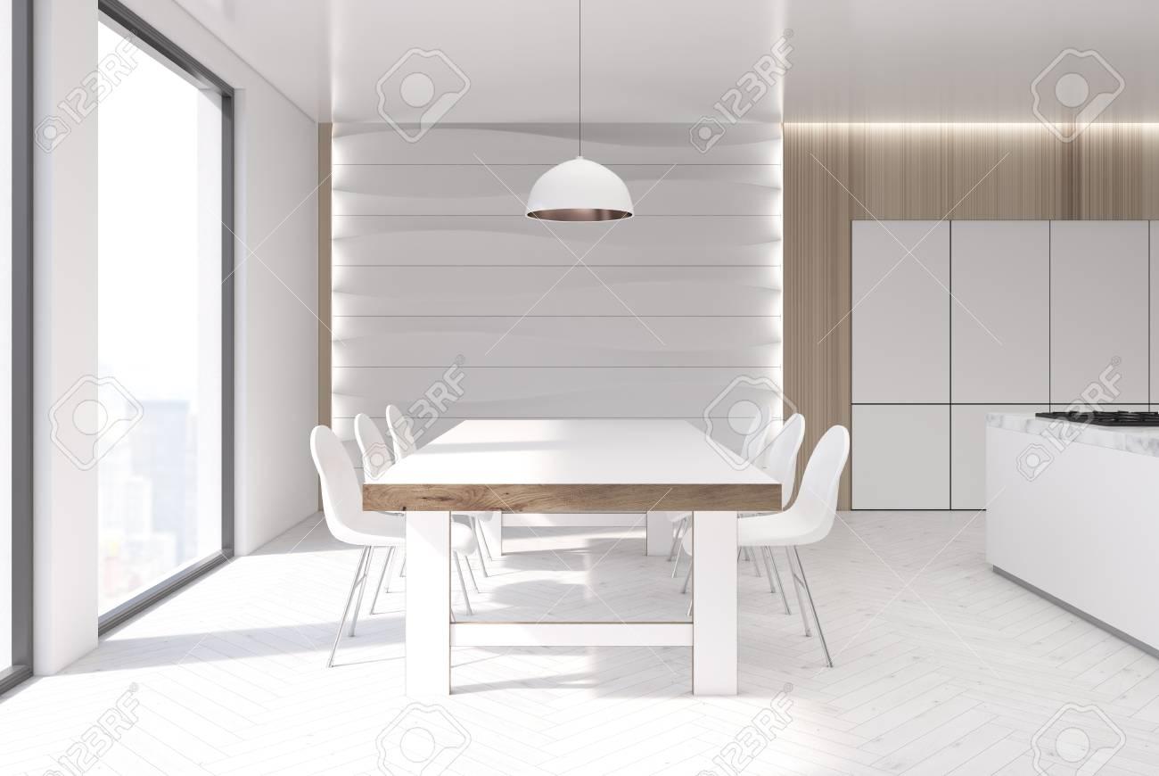 interieur de cuisine blanc et bois avec un element de decoration ondule un sol blanc une longue table en bois avec des chaises blanches autour et