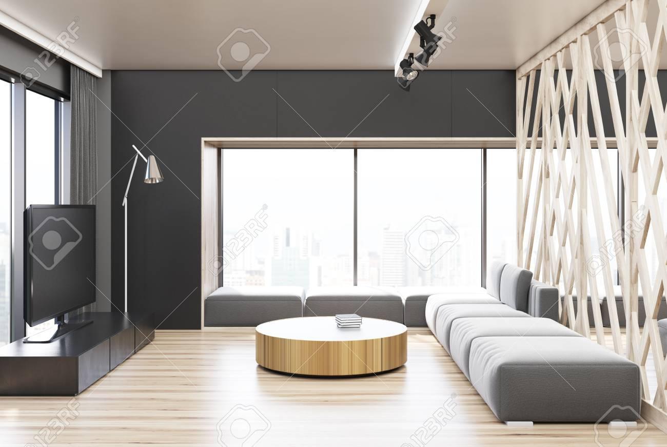 interieur de salon gris avec un mur et un plancher en bois un canape gris un televiseur et une table basse ronde rendu 3d