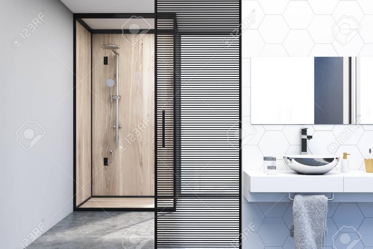 carrelage hexagonal et interieur de salle de bain mural blanc avec un double evier pose sur une etagere en bois et une cabine de douche en verre et