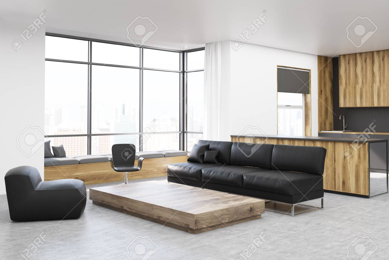 white and wooden living room corner with a black sofa a wooden