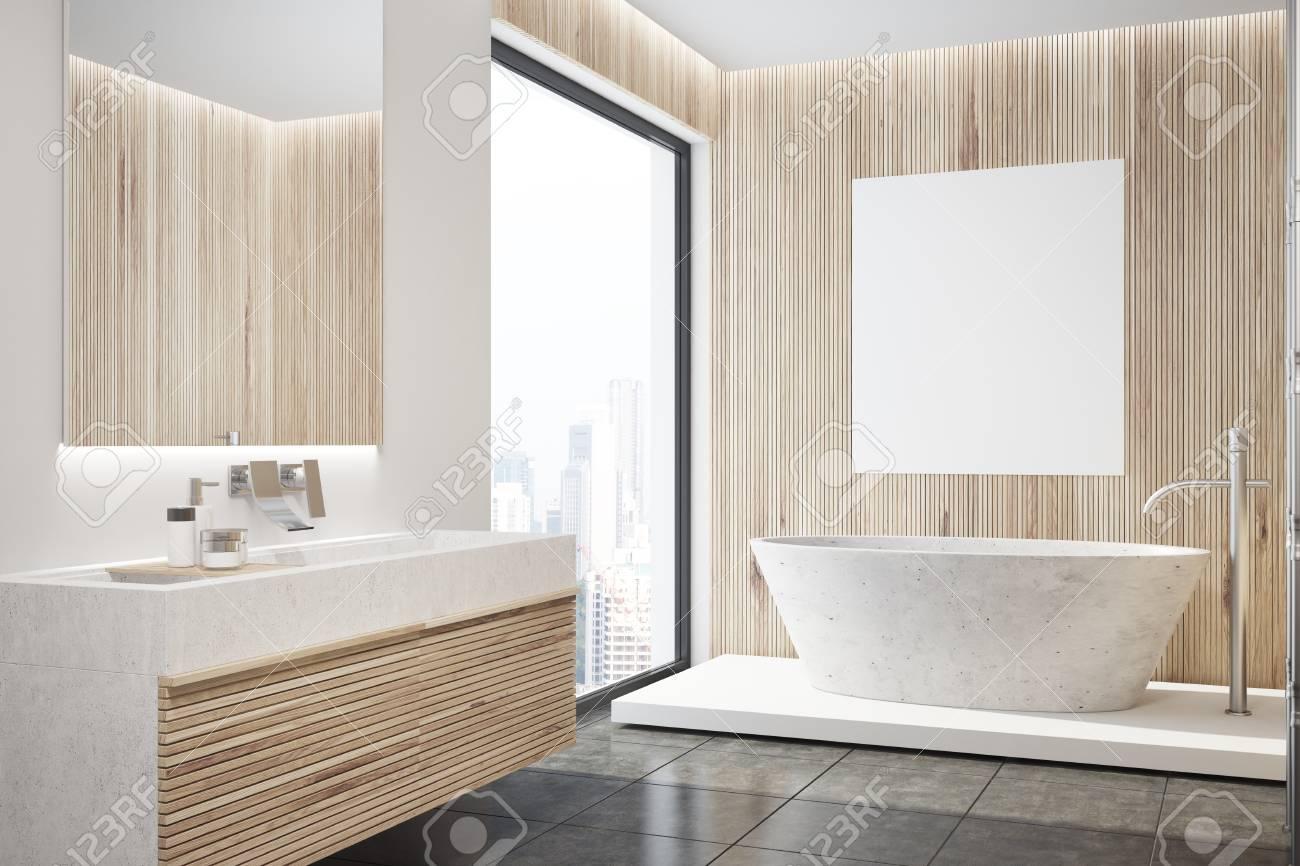 interieur de salle de bain moderne avec des murs en bois un sol noir un lavabo et une baignoire blanche avec une affiche suspendue au dessus une